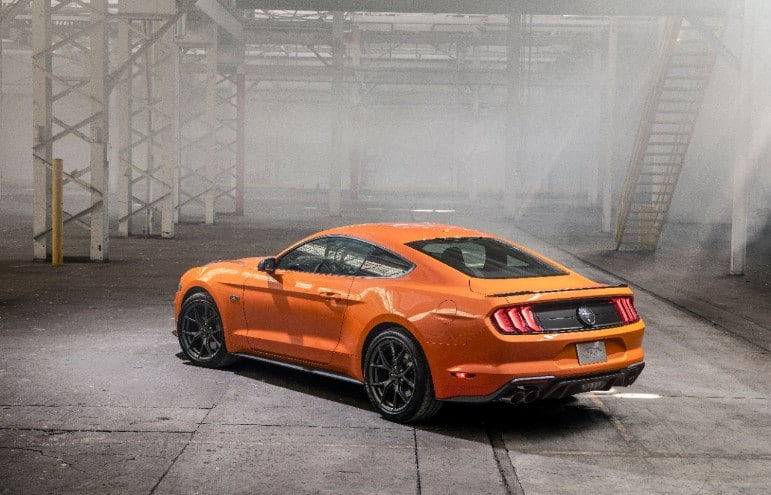 The rear view of an orange 2020 Ford Mustang EcoBoost High Performance