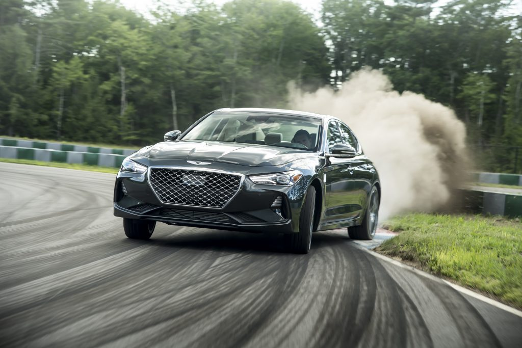 2019 Genesis G70 sedan drifting around a racetrack