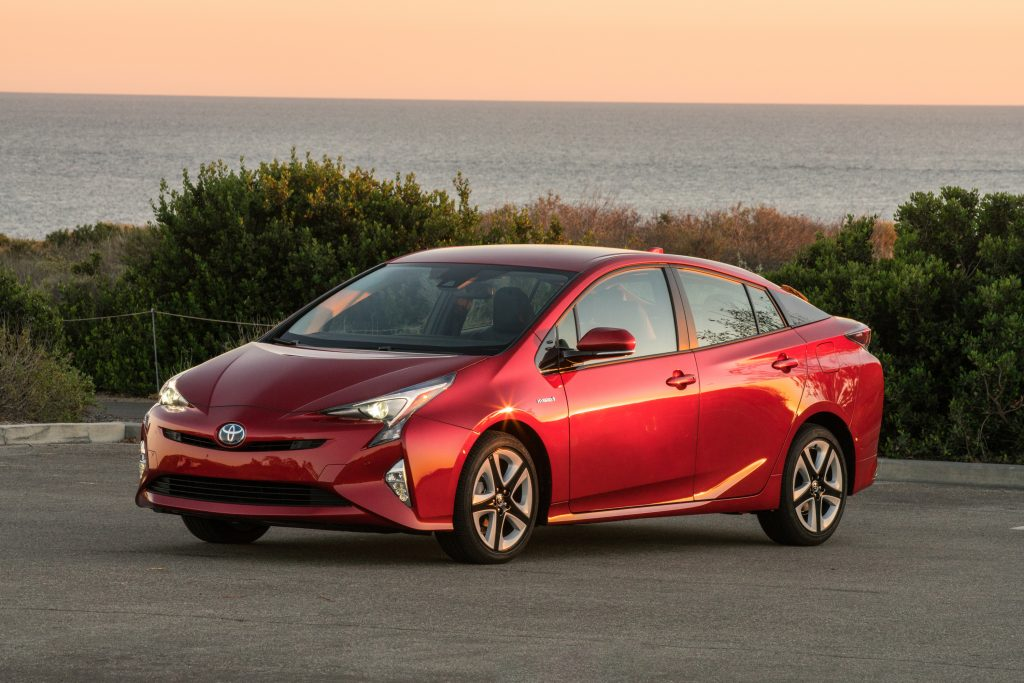 a red 2016 Toyota Prius parked