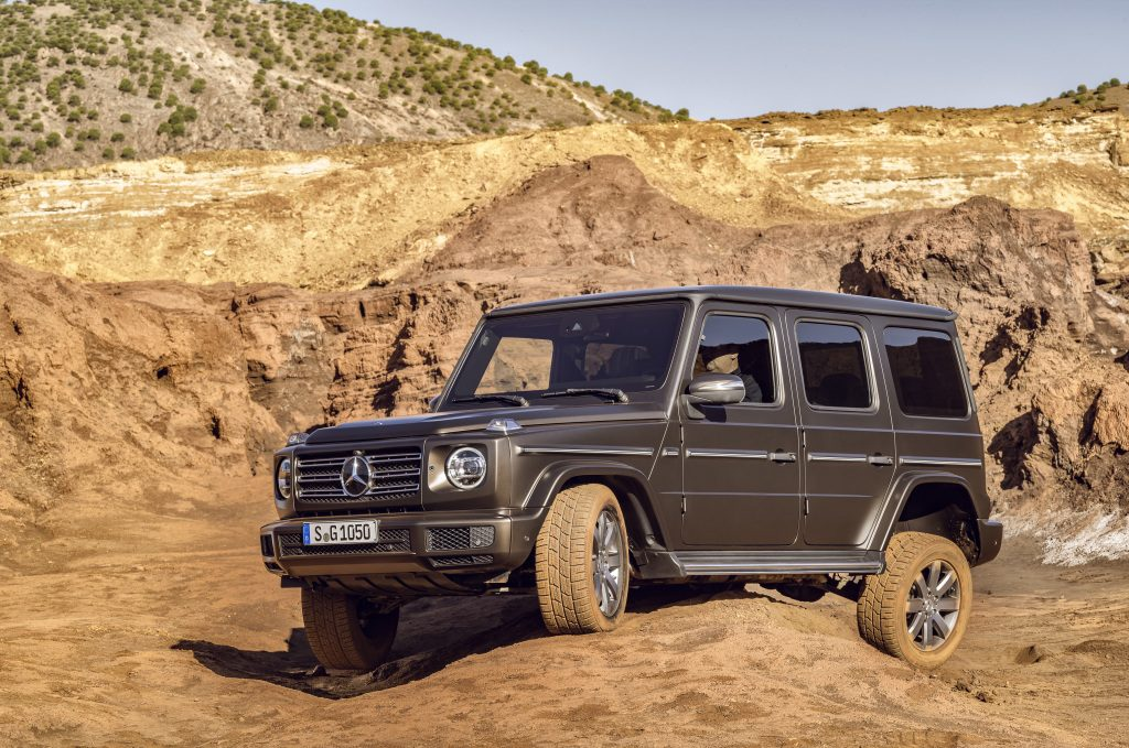 an overland camper van build all starts with a G-wagon like this one proving its off-road prowess in the sand