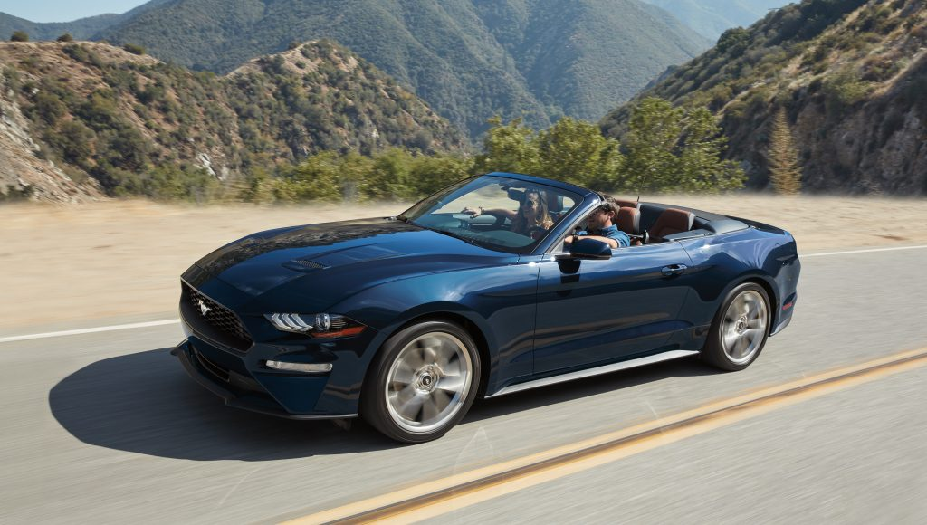 A 2019 blue Ford Mustang Ecoboost Convertible on the track.