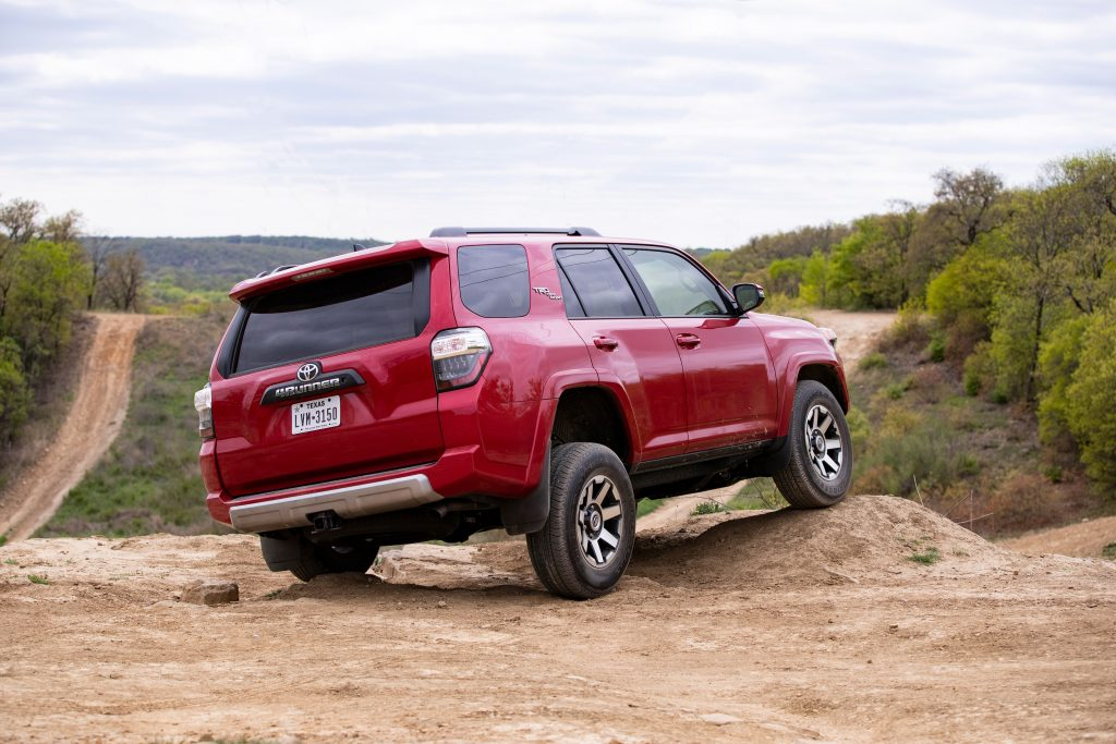 a rear shot of a red toyota 4runner
