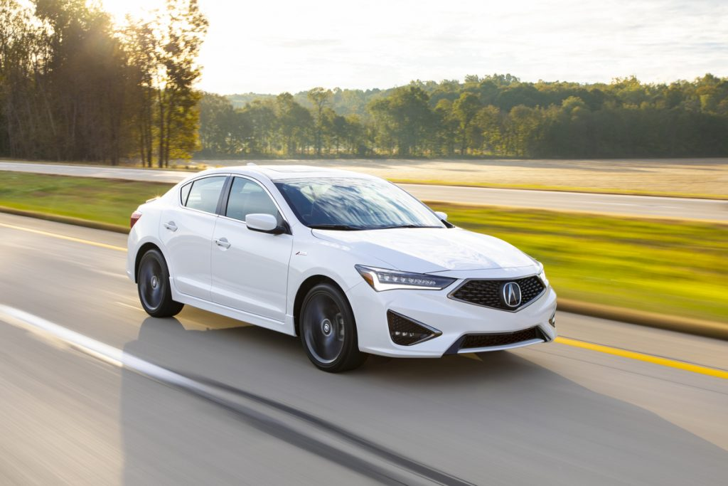 A white 2019 Acura ILX A-Spec drives down the road.