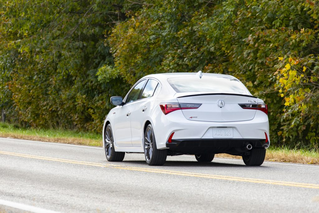 2019 Acura ILX A-Spec from behind, driving on country road