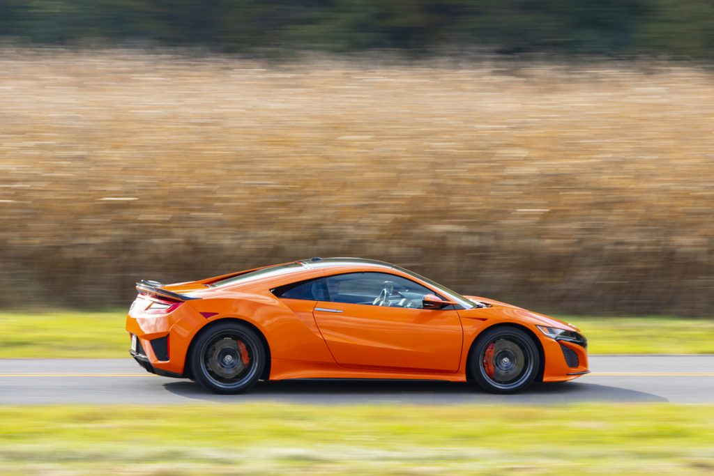 a side shot of a second-generation acura nsx in orange