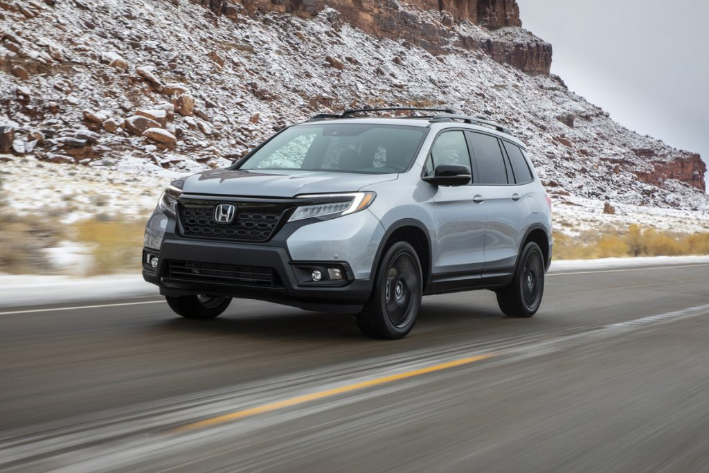 this gray 2020 Honda Passport with black wheels is racing through the mountains and looks just like Alexander Rossi's