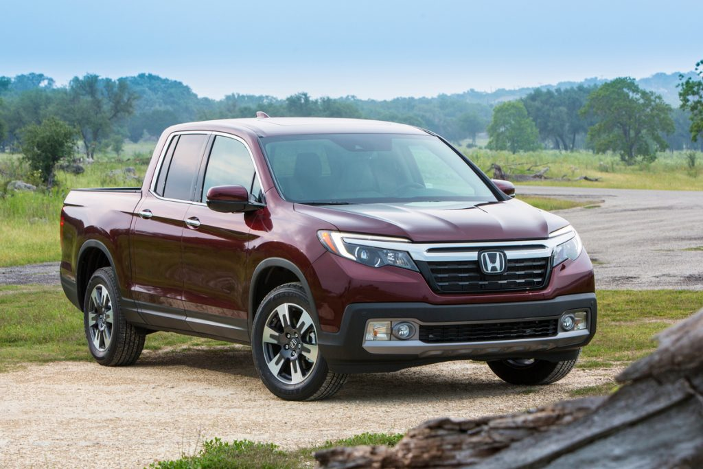 2019 Honda Ridgeline parked in sand near stream for off-roading
