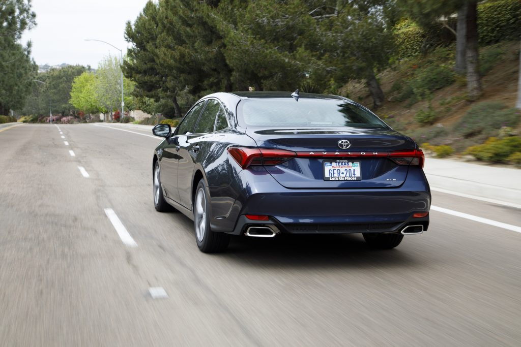 a redesigned Toyota Avalon at speed on the road