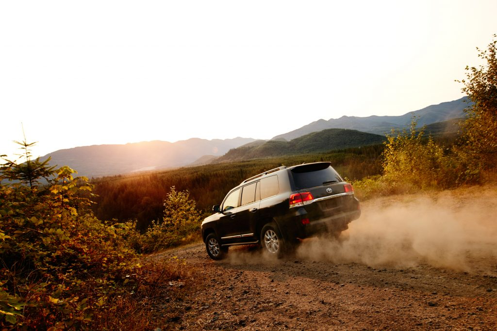 2019 Toyota Land Cruiser rear, driving away into the desert