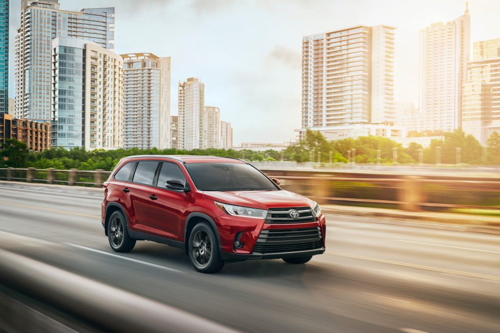 2019 Toyota Highlander driving down the highway