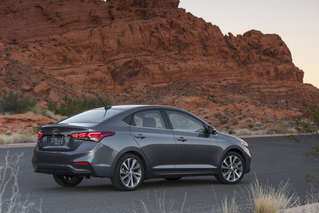 Gray 2018 Hyundai Accent parked on the road in the mountains