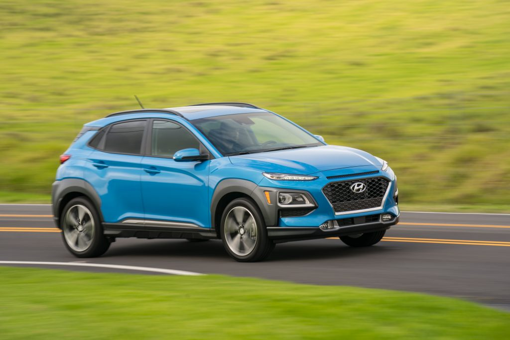 Hyundai Kona driving down country road