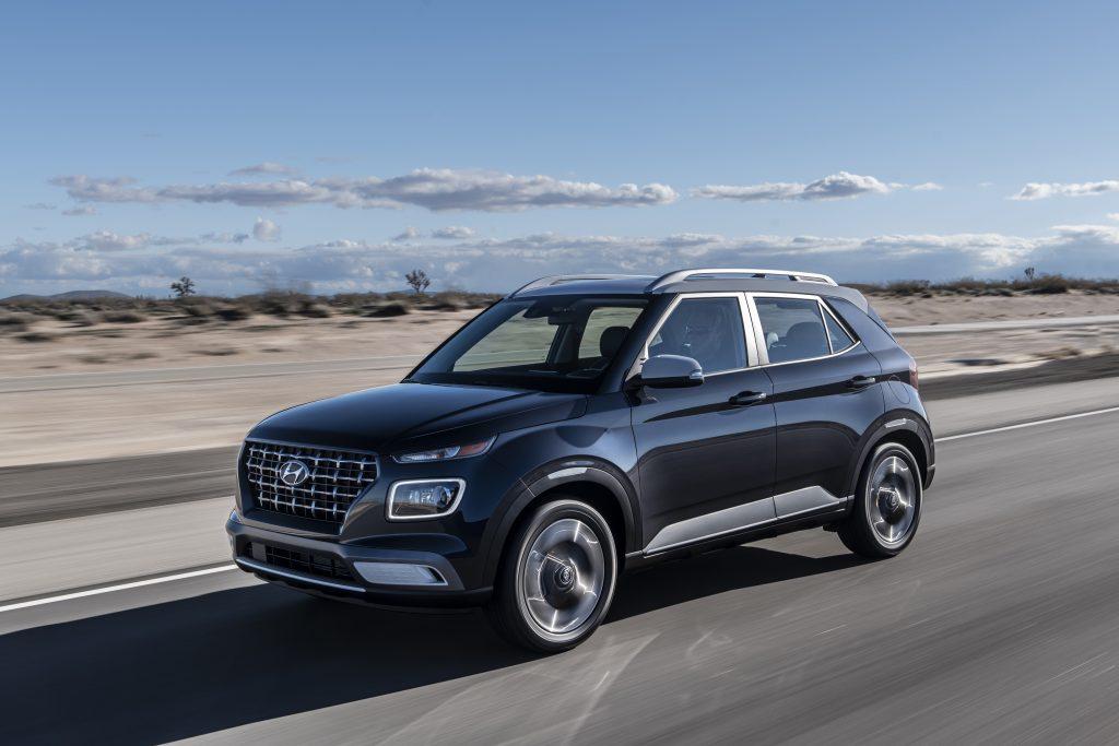 2020 Hyundai Venue driving down road near beach