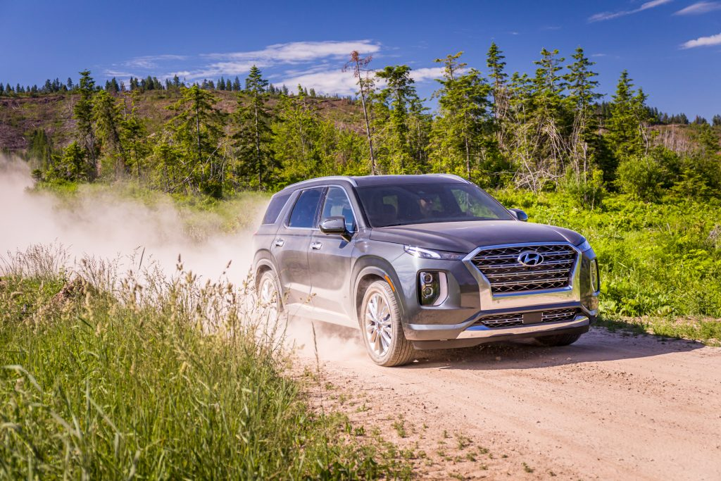 Hyundai Palisade driving down dirt road