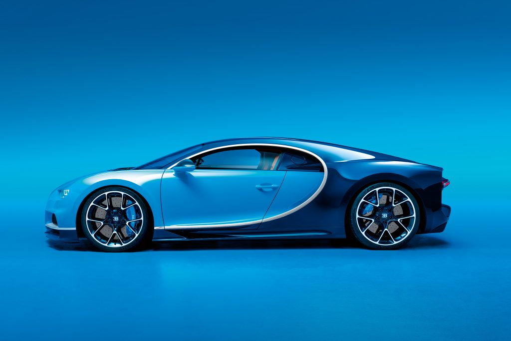 The side view of a light-blue-and-dark-blue Bugatti Chiron
