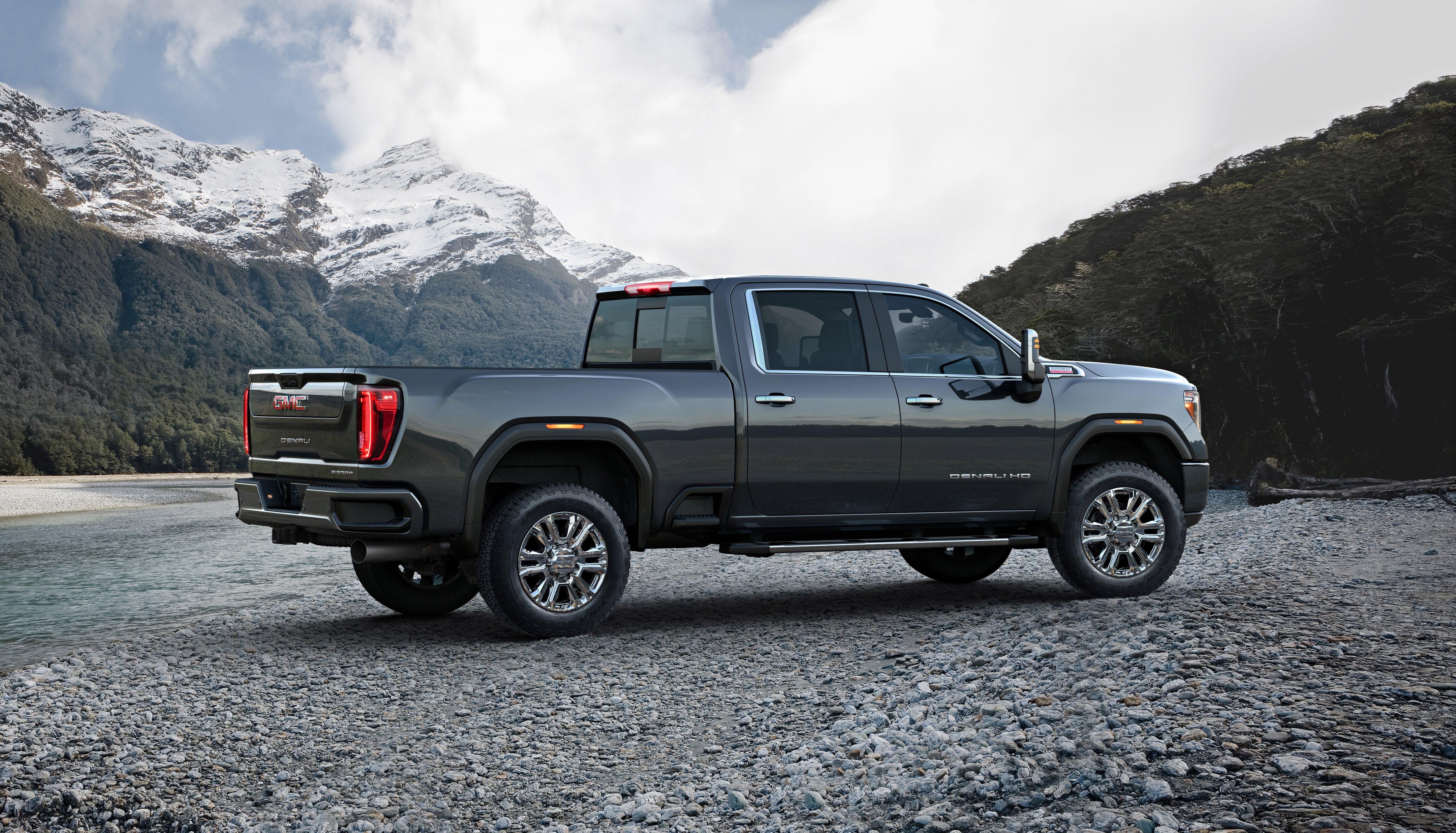 The GMC Sierra 2500HD parked off road in the mountains.