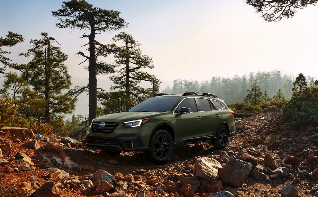 A 2020 Subaru Outback parked off-roading in a forest.