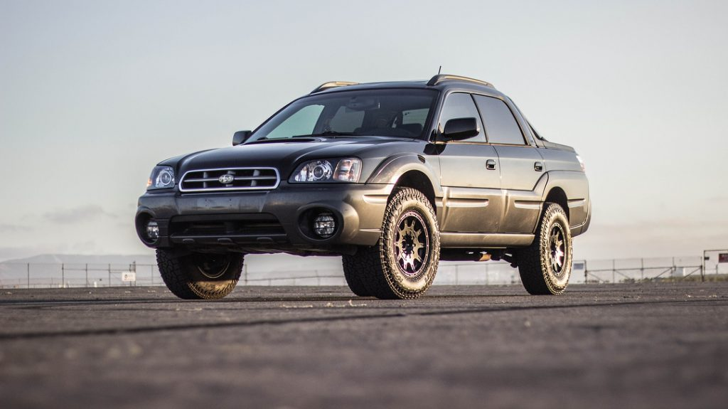 a Subaru Baja ute pickup truckparked on the pavement