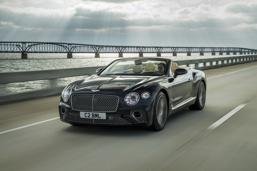A Bentley convertible crosses a bridge