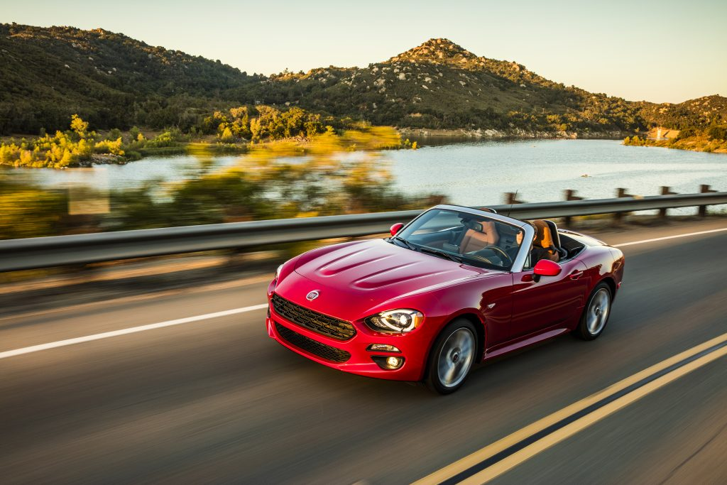 2020 Fiat 124 Spider Lusso driving down a beatufiul mountain highway.