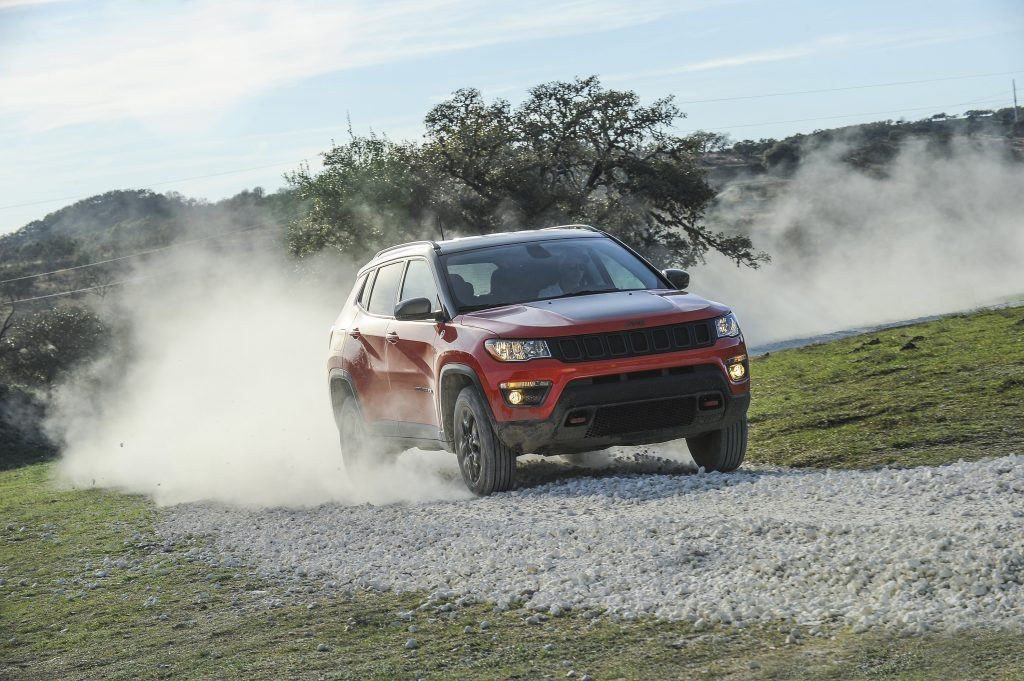 2019 Jeep Compass driving through sand