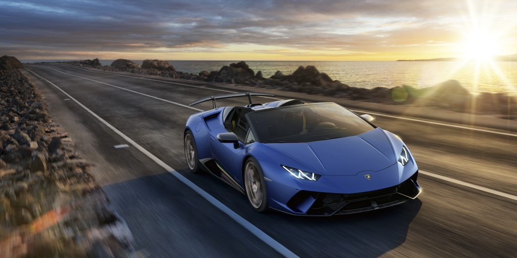 Lamborghini Huracan Performante Spyder driving down a coastal road
