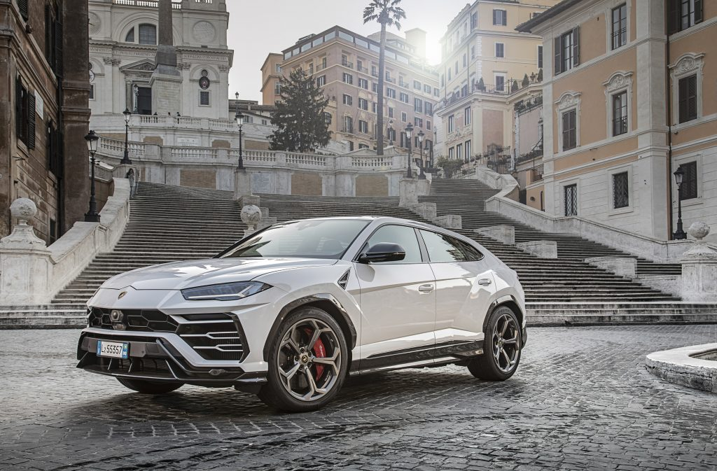 An image of a Lamborghini Urus SUV rolling down the road.
