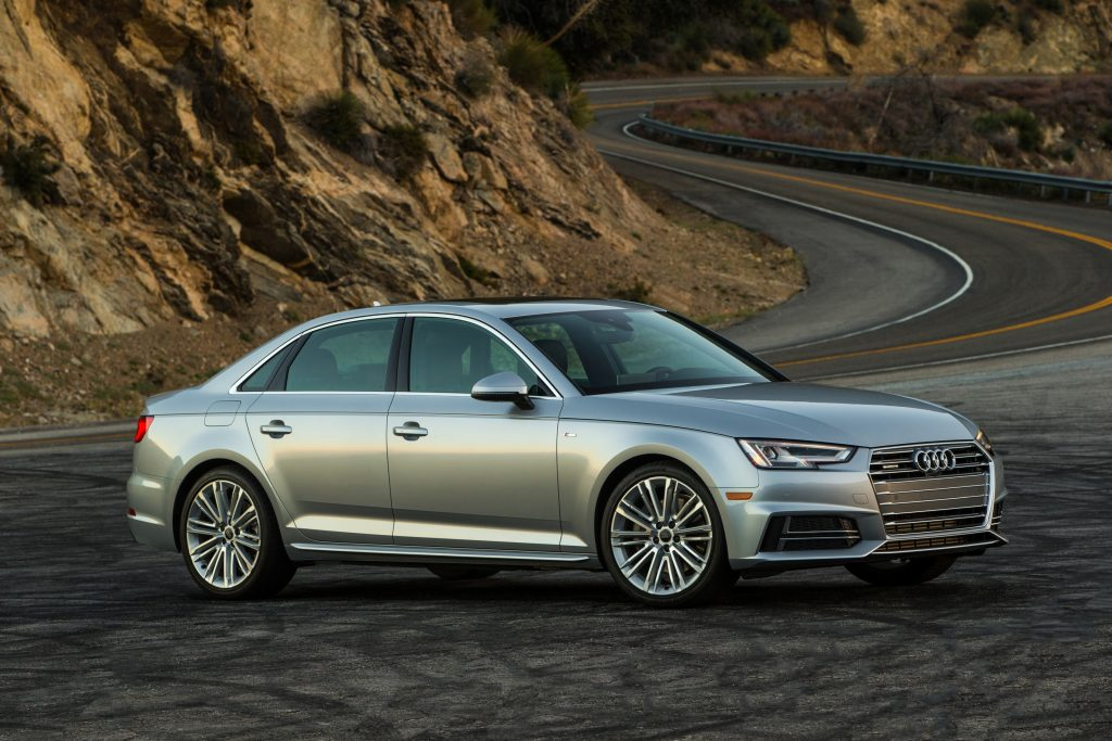 silver Audi A4 parked near a mountain road