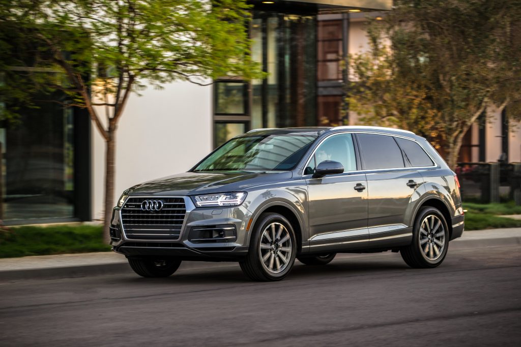 A grey 2017 Audi Q7 parked  curbside.