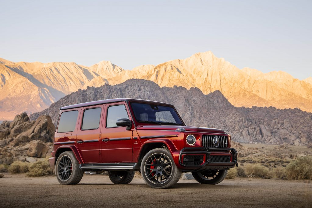 A red 2020 Mercedes-AMG G63 parked by the side of a scenic canyon road.