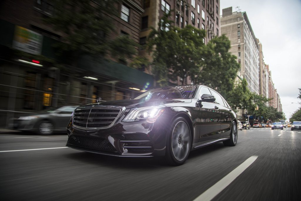 2018 Mercedes-Benz S-Class luxury car in motion on a city street