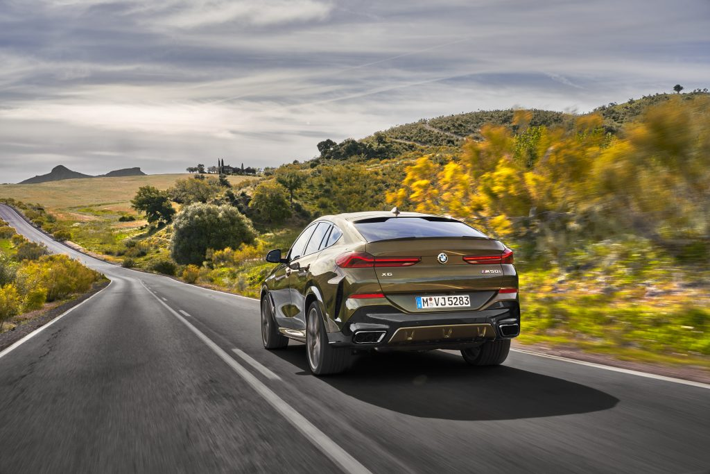 rear view of a BMW X6 driving on the road