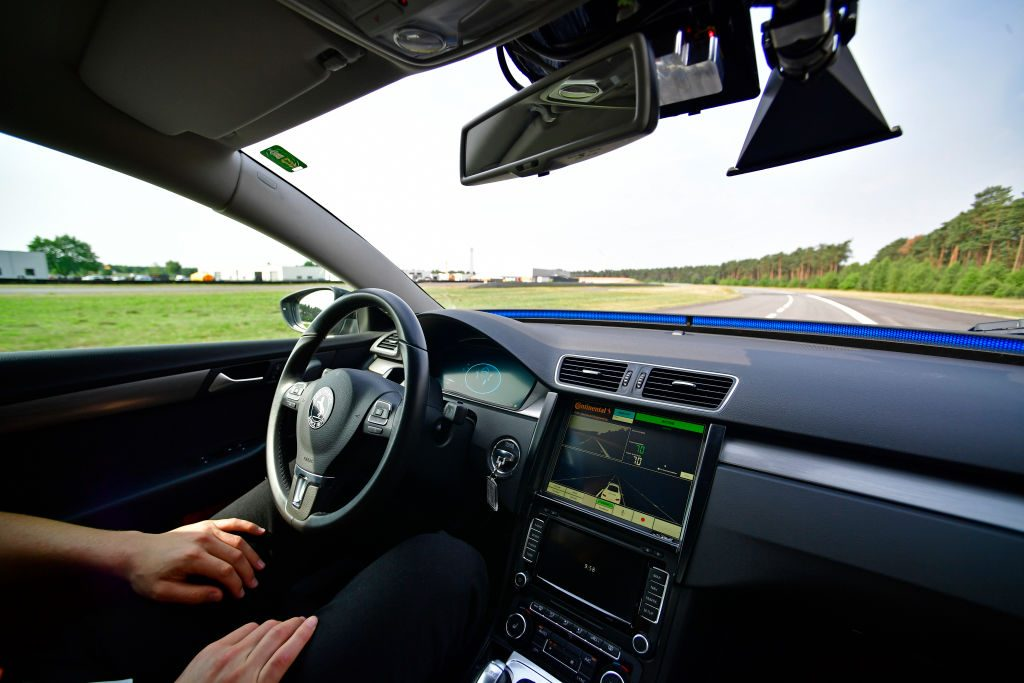 A passenger in a self-driving car.