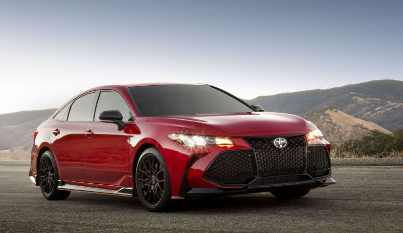 A red 2020 Toyota Avalon TRD out in the  country.