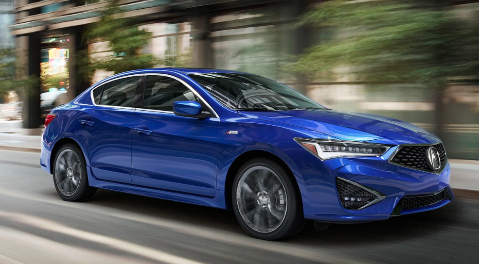 Acura ILX zooming down urban street