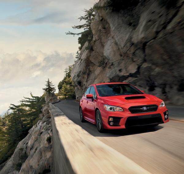 2020 Subaru WRX driving on a canyon road.