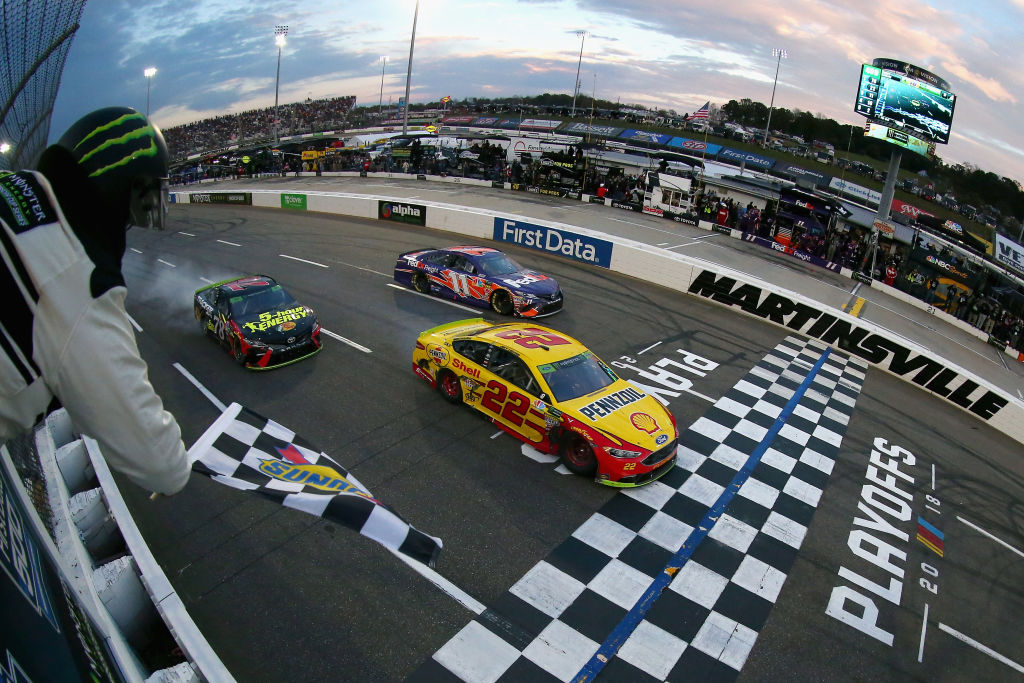 NASCAR racecars crossing the finish line.