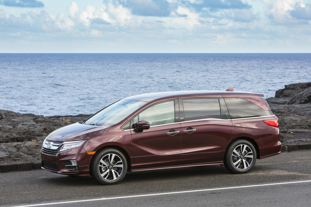 burgundy 2020 Honda Odyssey driving along a shoreside roadway