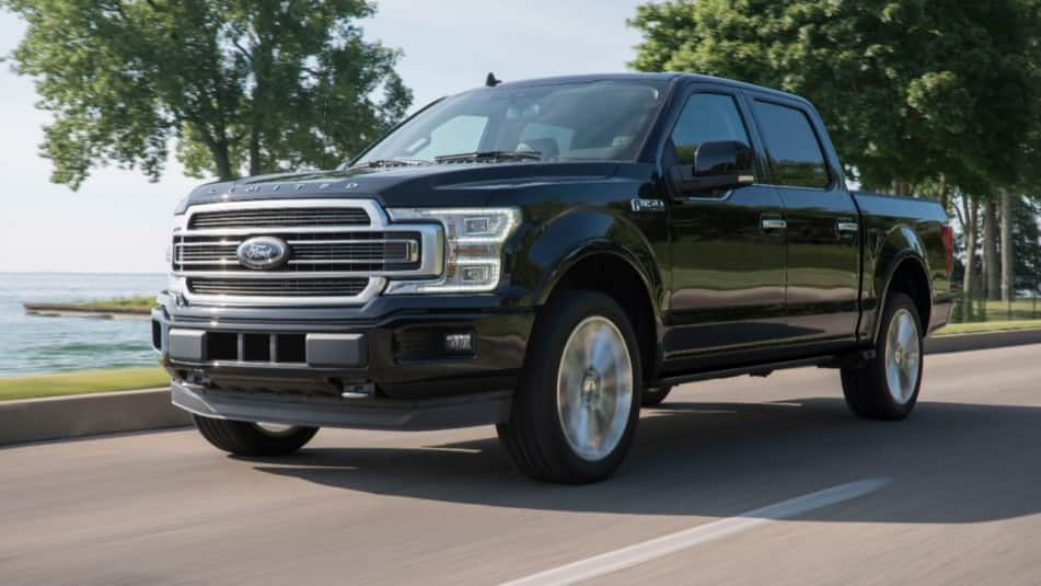 2020 Ford F-150 pickup truck driving on a shoreside road