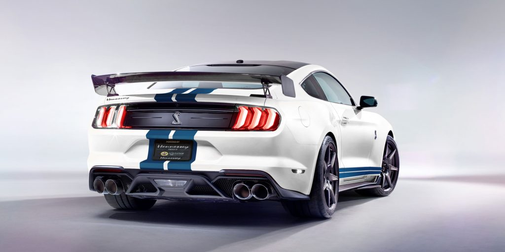 White 2019 Mustang with blue competition stripes