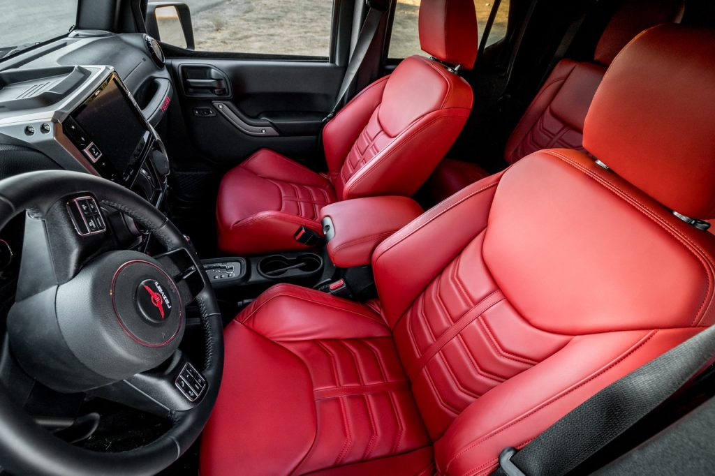 The Rezvani Tank SUV's interior, showing leather dashboard and red leather seats