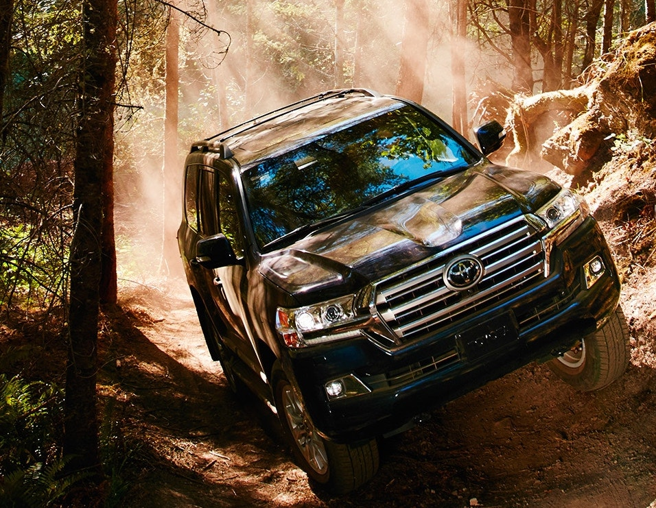 2019 Toyota Land Cruiser off-roading over rocky trail