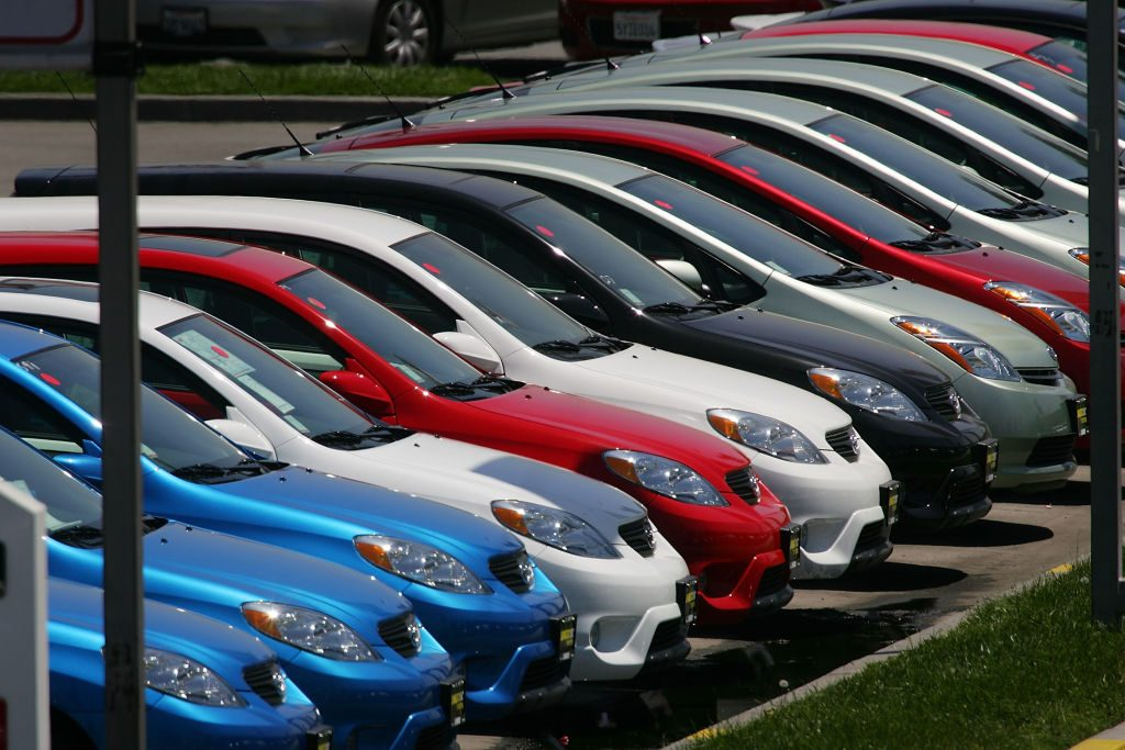 Rows of Toyota cars for sale at a dealership
