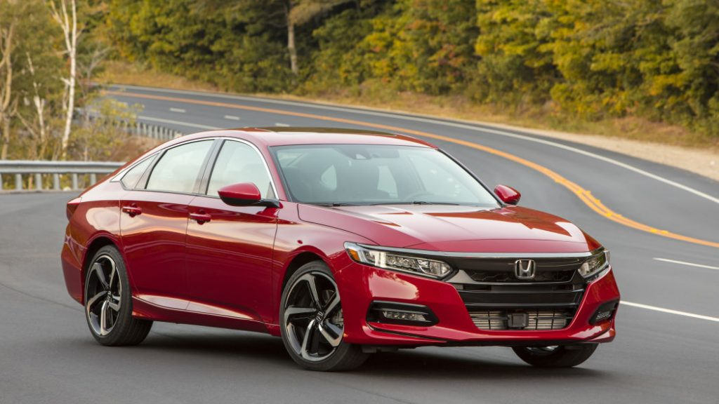 a red 2018 Honda Accord sedan on a winding scenic road is a primary example of the successful engineering by this car company