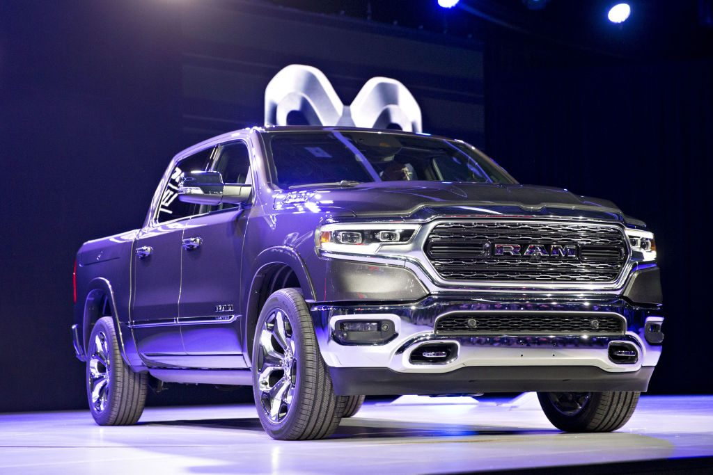 A 2019 Dodge Ram pickup truck on display at an auto event.