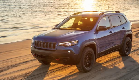 This 2020 Jeep Cherokee driving along the shore is one of the vehicles that comes equipped with a Tigershark engine