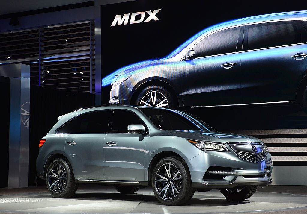 Acura MDX crossover being displayed at a motor show.
