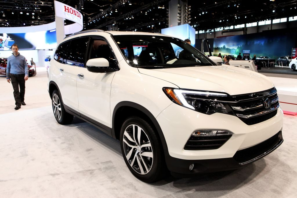 Honda's largest of its crossovers the Pilot on display at an auto show.