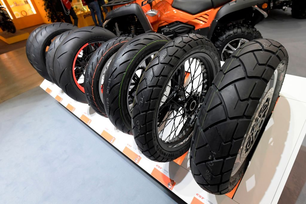 Motorcycle tires are displayed at moto show