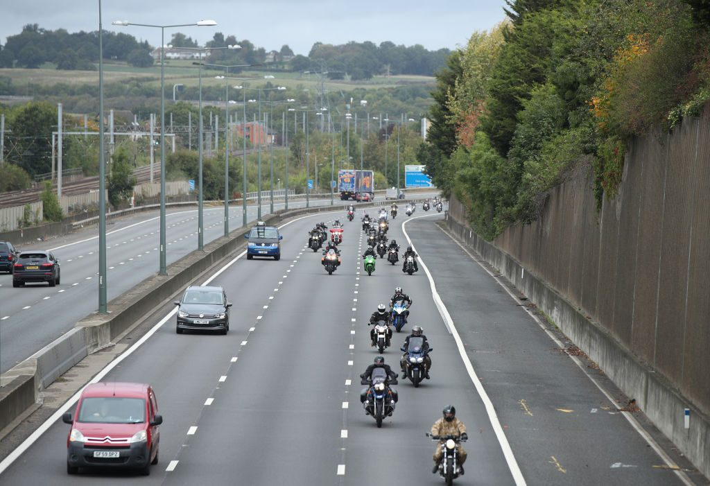 Motorcycles drive along the M1 motorway toward central London
